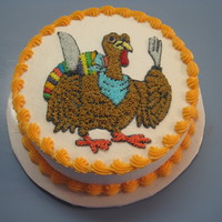 "Turkey 8"" round, two layer chocolate cake with buttercream icing."