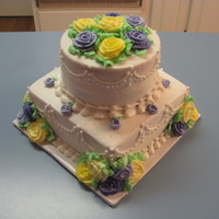 "Purple/yellow Shower Cake   2 layer 8"" square cake and 2 layer 6"" round, chocolate and French vanilla layers, iced in all buttercream."