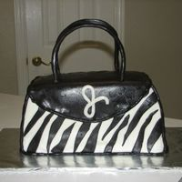 Zebra Purse Done for a friend's Birthday! She loved it. Made with MMF...have to say thanks for the posting of the MMF made with crisco. Until then...