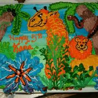 Zoo Animal Birthday Cake The animals were made from cut pieces of cake and buttercream frosting, flowers and trees are all frosting.