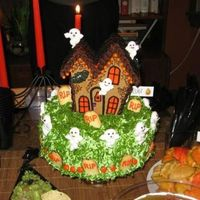 Halloween Haunted House Haunted Gingerbread house topping a Halloween garden visited by not-so-scary ghosts.