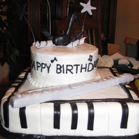 Musical B-Day Cake   This cake was for my two nieces...one who loves to play the piano and the other who loves to play the flute. They loved it!