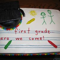 "Kindergarten Graduation Cake This was for my son's kindergarten graduation. He wrote ""First grade here we come"" and drew the picture of the people... I..."