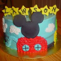 Mickey Mouse Clubhouse Two-layer white cake with buttercream icing and detail. Mickey's head on the clubhouse is made from fondant, as well as the stars on...