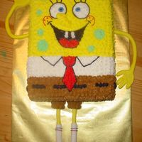 Spongebob Squarepants 9x13 white cake with butercream icing and detail. Arms and legs made of fondant.