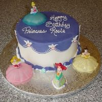 "Disney Princess Cake 8"" White cake with strawberry filling and buttercream icing. Friend's daughter wanted 4 princesses on her cake since she is..."