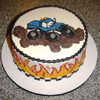 "Monster Truck 10"" chocolate cake with oreo filling and buttercream icing. Flames and truck hand painted."