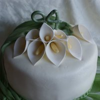 Cala Lily Birthday  A double layer 10 inch white cake covered with vanilla butter cream than home made fondant icings. The calla lilies and the number 94 are...