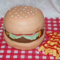 Hamburger & Fries  Hamburger & Fries - This cake is a triple layer chocolate cake filled and covered with vanilla butter cream and home made fondant. The...