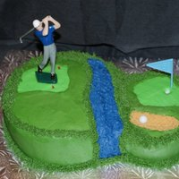 Golfer Cake Golf Cake - This cake was for my husband on his birthday! It is an eight inch chocolate round double layer cake with a 6 inch round single...