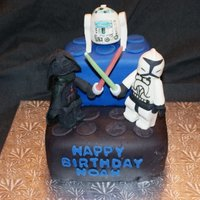 Lego Star Wars Lego Star Wars - An eight inch square double layer chocolate cake topped with a four inch double layer square white cake. Both cakes are...