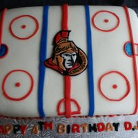 Ottawa Senators Birthday Cake A 9x13 sheet cake, chocolate in flavor, for a hockey fan (or the son of a Senators fan at least!). The cake is covered with vanilla butter...