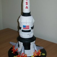 "Blast Off My first rocket cake! Oh, how we learn on our firsts! Can't wait to do another and improve it! 4 and 3"" stacked and carved...."