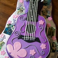 Taylor Swift Inspired Guitar Cake The birthday girl LOVES Taylor Swift. She also LOVES purple.....so this is what we came up with! Covered in buttercream with fondant...