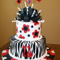 Black And Red Sweet 16! Fun cake for a darling girl turning 16! Covered in buttercream with fondant accents! TFL! Still need to ribbon the board...LOL!