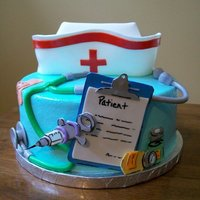 Graduation From Nursing School Quick little cake made for a friend who just graduated nursing school. Covered in buttercream with fondant accents!