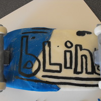 Blind Skateboard  French Vanilla Cappucino Cake covered in Modelling Chocolate. Logo is painted on with food color. This is for my nephew. He tasted the...