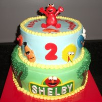 "Sesame Street Elmo Birthday! 10"" and 8"" vanilla butter cake with vanilla buttercream icing. and strawberry buttercream filling. All accents were made from MMF..."