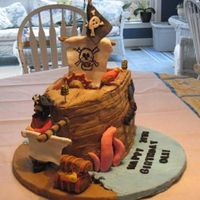 Pirate Ship   I made this for my husband's birthday. It had a pirate, parrot, kracken, treaure chest, cannons and edible fondant sails.