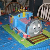 Thomas The Train / Tank Engine 3D  My husband and I made this cake for our nephew's third birthday. Everything was completely edible (face was made from gumpaste). I...