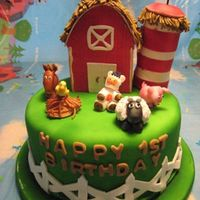 Farm Cake I made this cake for my nephew's first birthday. It had a gumpaste barn, silo and various farm animals.