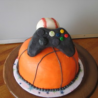 Sports Themed Cakes Cake for teen boy. I was told he likes basketball, baseball and video games. With some inspiration on this site, came up with this. The...