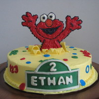 Elmo Cake This is a 2nd birthday cake for my friends' son. Frosted with BC, accent pieces are all candy clay and the Elmo is a choc transfer....