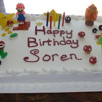 Super Mario Cake Thrown together last minute for our friends son, everything but the Mario, Donkey Kong, and Yoshi are made out of gumpaste. Cake is from...