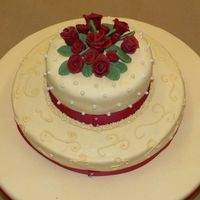 Wilton Class Iii Final Cake MMF cover dummy, the main cake layer is french vanilla with raspberry, mmf and free hand scrolls, top is butter yellow and creme de menthe...
