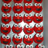 Elmo Cupcakes I made these Elmo cupcakes for a little girl's birthday party. I also made a coordinating Elmo mini cake especially for the birthday...