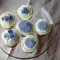 Purple And Lavender Flower And Monogram Cupcakes A friend asked me to make cupcakes for her daughter's wedding. I am just playing around with some designs to see what sort of styles...