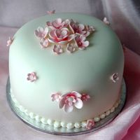 Pink Blossom Mini Cake This is a 4 inch lemon cake covered in Michele Foster's Fondant. The pink blossoms are all gumpaste. TFL