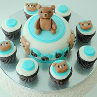 Teddy Bear Baby Shower Mini Cake & Cupcakes We had a surprise baby shower for my brother and my sister-in-law who were visiting from out of town. I based the cake and cupcakes on my...