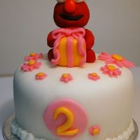 Elmo Mini Cake This was an Elmo mini cake that I made for a little girl turning 2. I also made matching Elmo cupcakes for her party guests. The little...