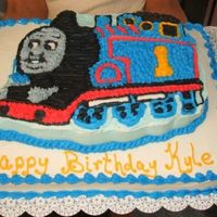 Thomas The Train A thomas cake (wilton Pan) on top of a half sheet cake. All vanilla withbc icing. made for for cousins sons birthday. i dont really dont...