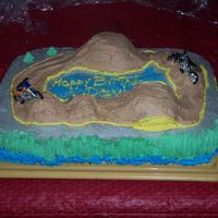 Dirt Bike Birthday Cake This cake was fun to do. The hills were made with different size cupcakes.