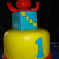 Nephew's 1St Birthday Made this as a smash cake for my nephew, everyone else is getting walmart cupcakes (gross). First time making fondant figure of anything......