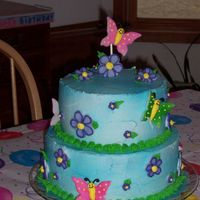 Butterfly Cake  My daugther turned 7 yrs. old in March. Saw this cake in a Wilton magazine. The butterflies are rolled fondant sprayed with color. Royal...