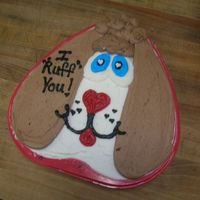 "Puppy Love Hear shaped cake with BC icing to look like a dog saying ""I Ruff You!"" for Valentine's Day"