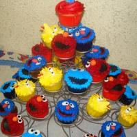 Sesame Street Cupcakes Sesame Street cupcakes for my son's 1st birthday party. Faces are buttercream, eyes, noses, beaks, etc. are fondant/gumpaste mix. I...