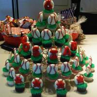 Baseball Cupcakes Baseballs are made with melted chocolate candies with buttercream red stripes. Letters & stars are cookies rolled in sprinkles then...