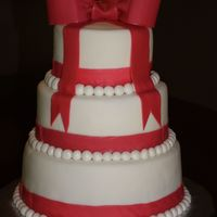 Tiered Pink Bow And Pearl Cake This cake was ordered for a birthday party... But I think it looks more like a wedding cake or a bridal shower cake! I loved it... the...