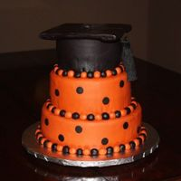Burnt Orange And Black Graduation Hat Tiered Cake This is a three-tiered cake I made for my cousin's graduation. The top is a hat-- with a tassel! I love it!