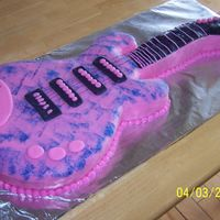 Hannah Montana Guitar Cake  Guitar base was cut with a template using a 11 x 15 cake; neck was made with a 9 x 13 cake. Covered with rolled fondant and sponged with...