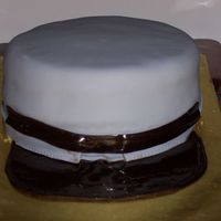 Civil War Kepi My husband & I are Civil War reenactors. I wanted a father's day cake that would reflect his love of the hobby. This cake is...