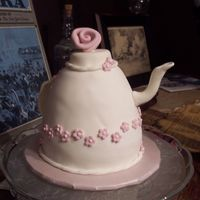 Teapot Cake Pink Flowers I made four of these teapots (2 w/pink flowers, 2 w/peach flowers). The pink ones are french vanilla cake w/buttercream filling, satin ice...