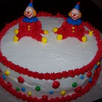 1St Clown Cake  How do you forget to take your cake to cake class?!?! Well, I did! I had to do it all on my practice board then come home and apply what I...