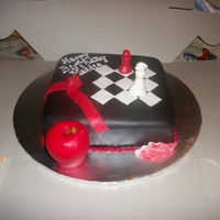 "Twilight Cake 8"" square cake covered in black MMF, rice crispie apple, and MMF chess pieces!"
