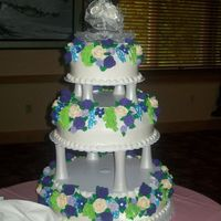 "Wedding Cake 16"", 12"" and 8"" round cakes iced with white buttercream and decorated with Royal Icing flowers!"