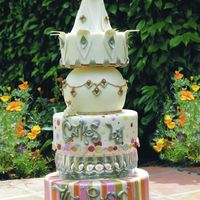 Our Logo Cake  This is our company logo cake. The company is named after the co-owner pastry chef, Mendy K. Pound. She spent many a long hours on this one...